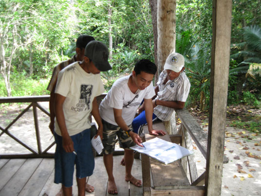 AlTo Conservation Officer trains a new crop of local villagers in how to record data as maleo guards