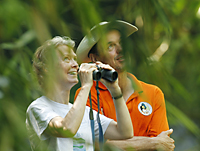 Marcy Summers, AlTo Director, and Duncan Neville, Program Advisor, with binoculars