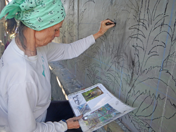 Mural Artist Sandra Noel using charcoal on Teku/Toweer Mural