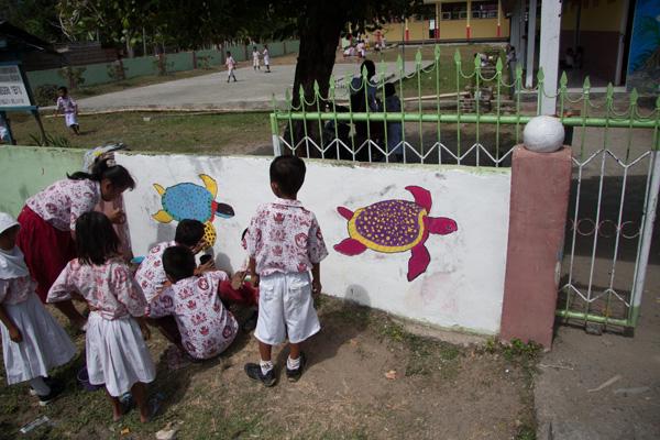 Turtles painted on wall outside school at Teku/Toweer