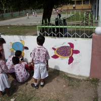 Turtles painted on wall outside school at Teku/Toweer