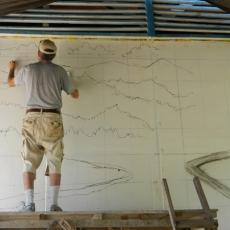 Will Forrester mulai mengerjakan lukisan dinding di Taima