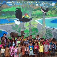 Kids in front of finished Teku/Toweer Mural