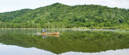 Fisherman in canoe, Teku Lagoon,Tompotika Peninsula, Central Sulawesi