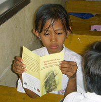 girl reading bat brochure
